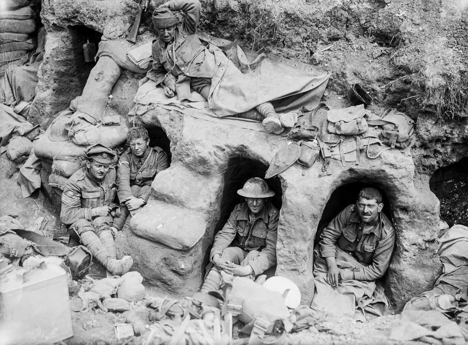 Men of the Border Regiment rest in shallow dugouts near Thiepval Wood. August, 1916.
