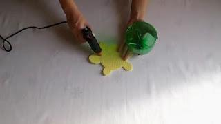 Membuat Sendiri Celengan Unik dari Botol Bekas