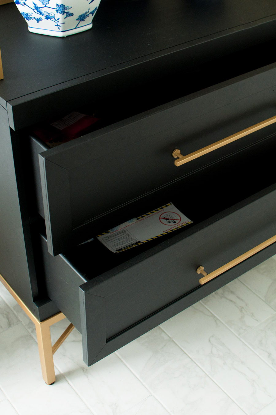 A gorgeous black and gold etagere or bookshelf from HomeGoods.