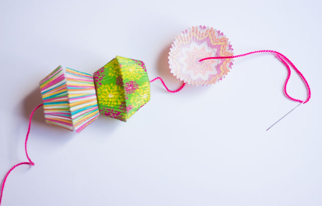 How to string cupcake wrappers onto a balloon