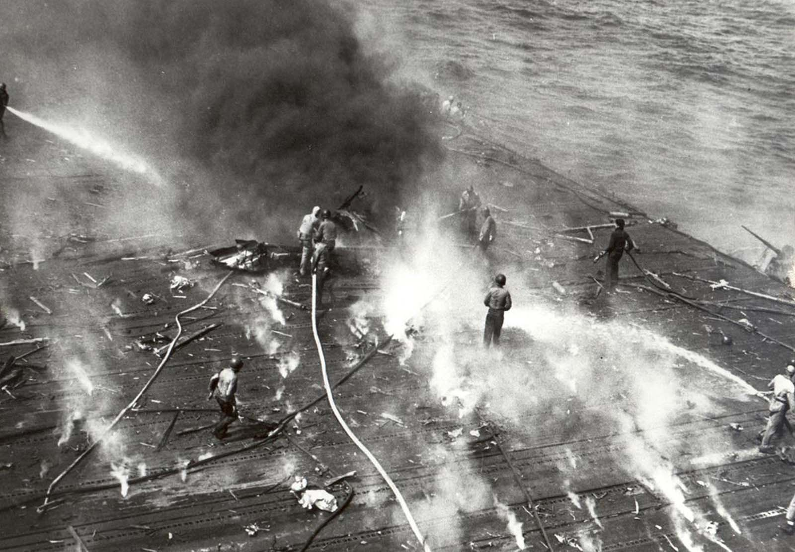 Black smoke pours from the aircraft carrier Yorktown after she suffered hits from Japanese aircraft during the Battle of Midway, on June 4, 1942.