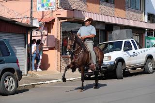Man riding horse in street of Santiago de Puriscal.