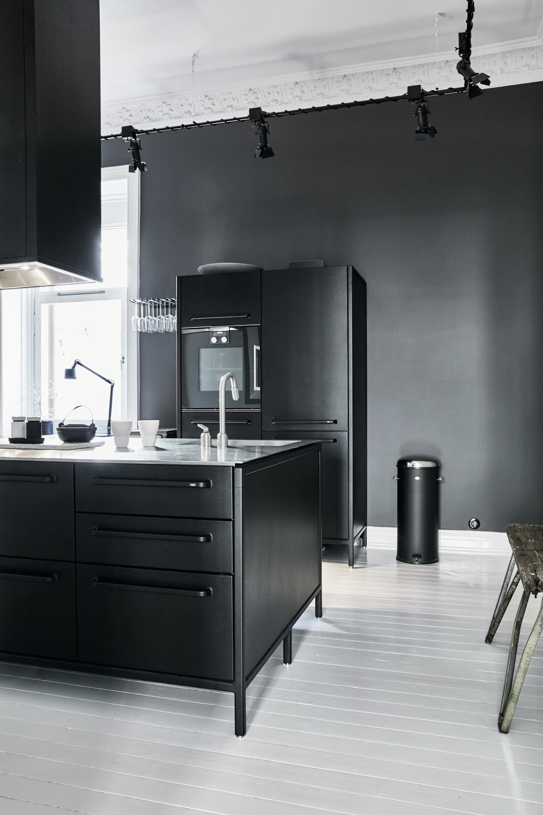 black painted kitchen design in a nordic apartment
