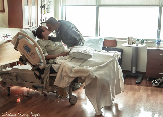 Husband and wife kiss in the hospital waiting for their baby to arrive. photography
