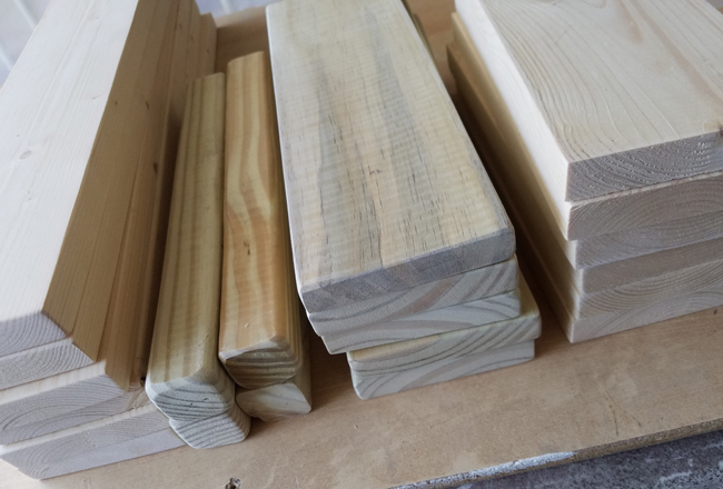 cut and sanded pine material for wooden crate.
