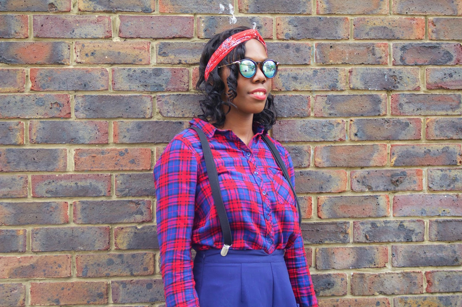 The Post Blogging Event Comedown, H&M checked shirt, H&M Red headband, ASOS green sunglasses, missguided navy high waisted shorts, black topshop braces, style blogger, fashion blogger, brick wall, uk blogger, black girls who blog