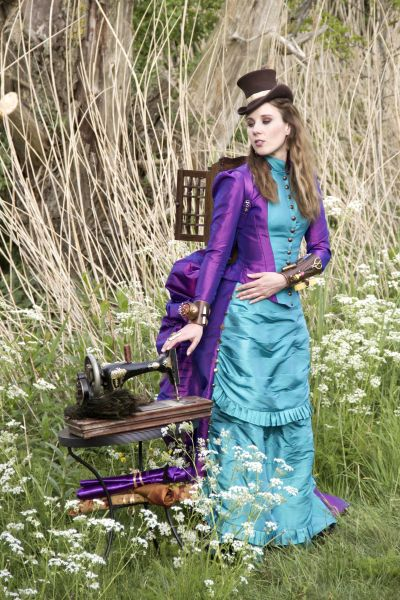 Steampunk Seamstress with antique Gritzer Durlach sewing machine and thread collection backpack