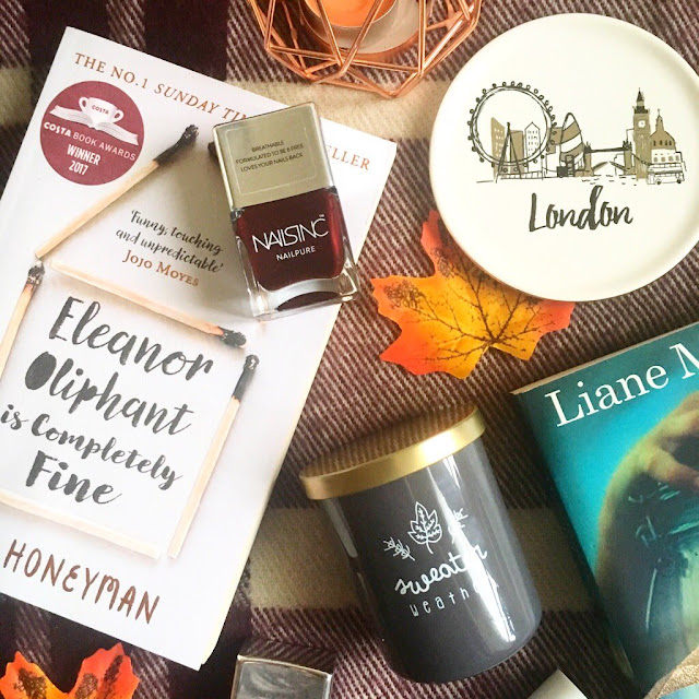 Autumn flatlay - dark toned nail polishes, books, London trinket dish