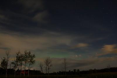 aurora behind stoopid clouds
