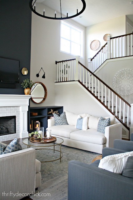 Dark blue gray color on big fireplace walls