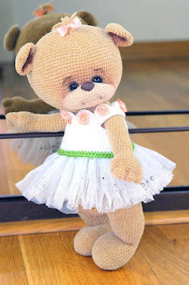 Cute amigurumi ballerina bear in tutu.