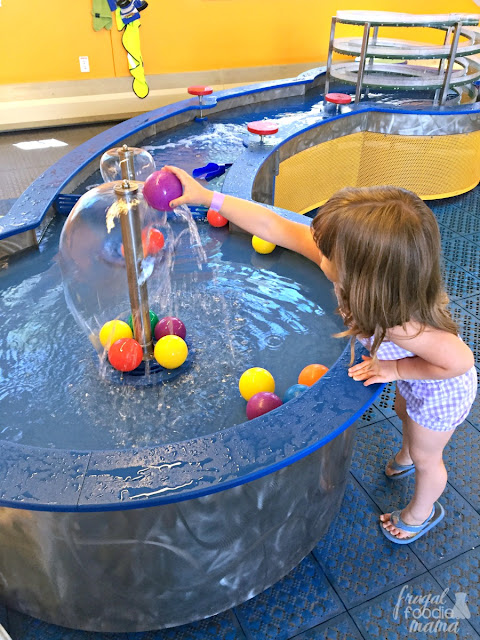 In Little KidSpace at COSI in Columbus, the little ones can safely explore and play in the area which includes a tree house, an ambulance, a barn complete with a pretend milking cow, a farmers market, a doctor's office, water play, a kid-sized climbing wall, and so much more!