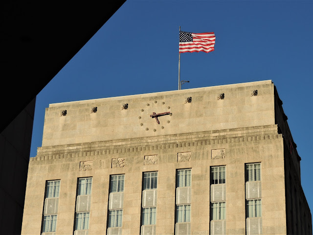 City Hall with Clock Dial and Flag atop