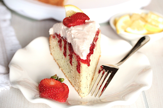 POPPY SEED STRAWBERRY POKE CAKE WITH PINK LEMONADE WHIPPED CREAM FROSTING