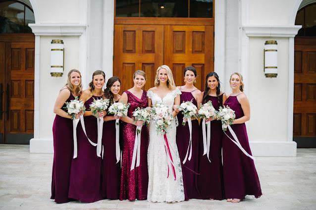 bride with maroon bridesmaids