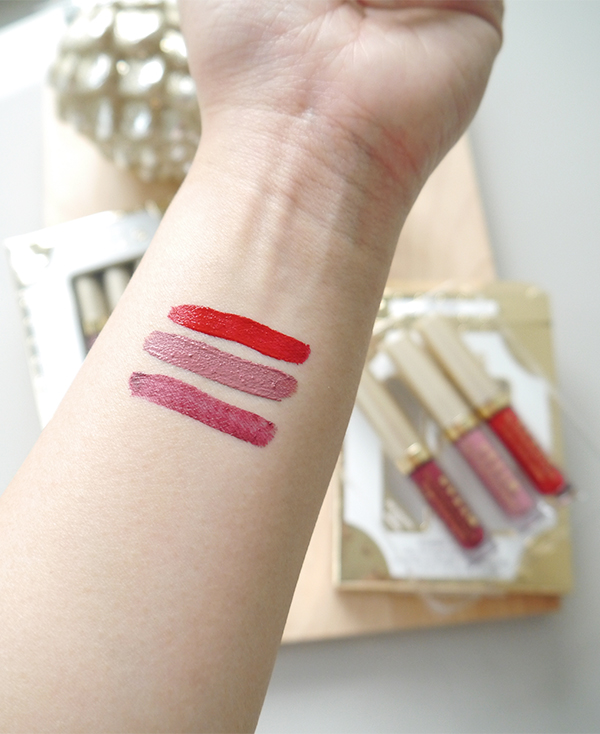 Stila holiday 2017 Sheer Delight Stay All Day Liquid Lipstick gift set includes new sheer shade Morello, Patina, and Fiery. Swatches photographed in natural light.