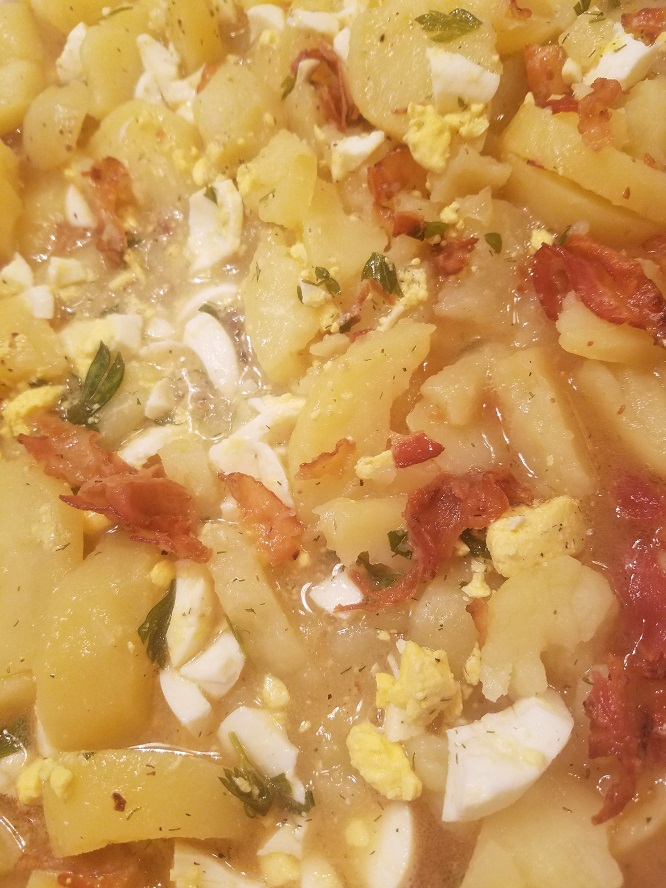 German Potato Salad is a creamy hot potato salad that is with bacon and herbs