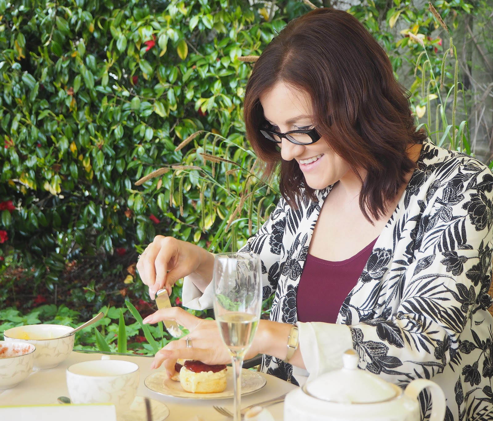 Afternoon tea review at South Lodge in Horsham - eating scones