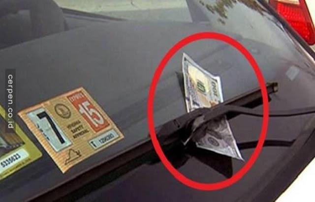 Waspada! Jangan Ambil Uang Yang Terselip Di Wiper Mobil, Ini Sangat Bahaya