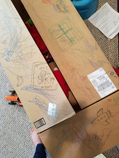 cardboard box and crayons