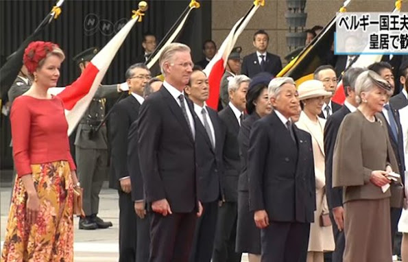 Belgian King Philippe and Queen Mathilde are welcomed by Japanese Emperor Akihito and Empress Michiko upon their arrival at the Imperial Palace. Mathilde Natan Dress