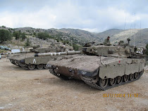 A pair of home-built Israeli tanks guarding the Syrian border, Golan Heights (annexed by Israel)