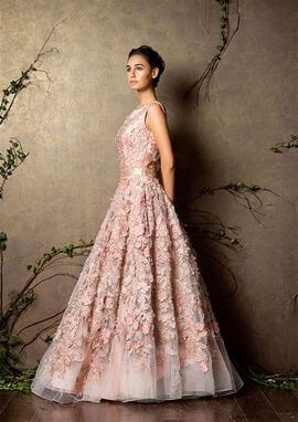 Sleeveless pastel pink color gown with floral patches is the Perfect fairy tale gown for any wedding party.