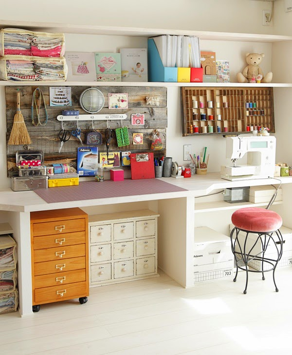 how beautiful is this craft room? I love the storage units under the extra large  sewing desk. #sewing #craftroom #homeoffice