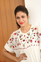 Lavanya Tripathi in Summer Style Spicy Short White Dress at her Interview  Exclusive 164.JPG