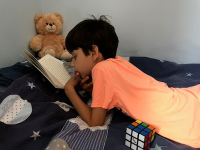 Child reading in his bedroom