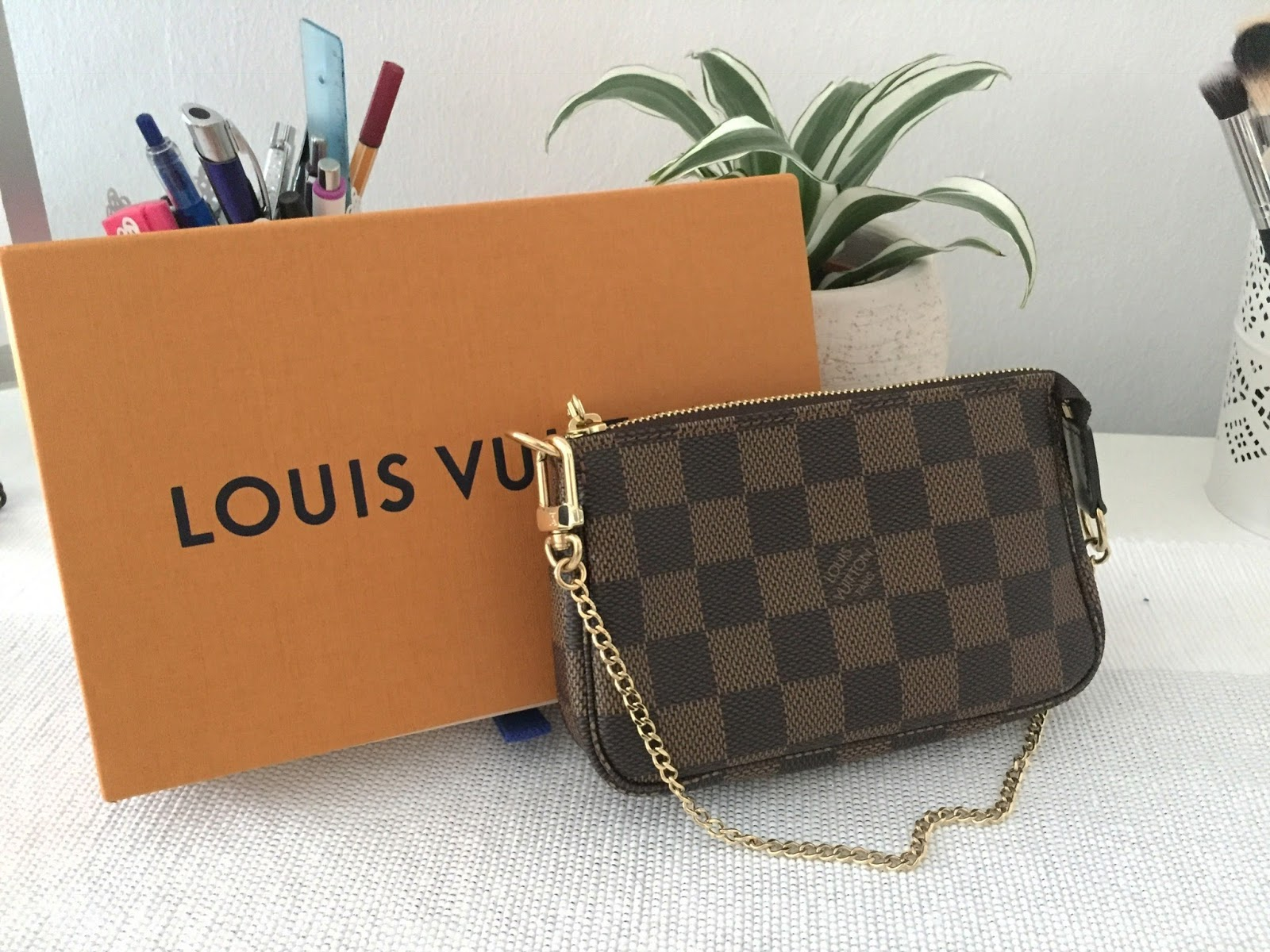 f7caf04eda27 Louis Vuitton Mini Pochette    What Fits Inside  - The Beauty Novel ...