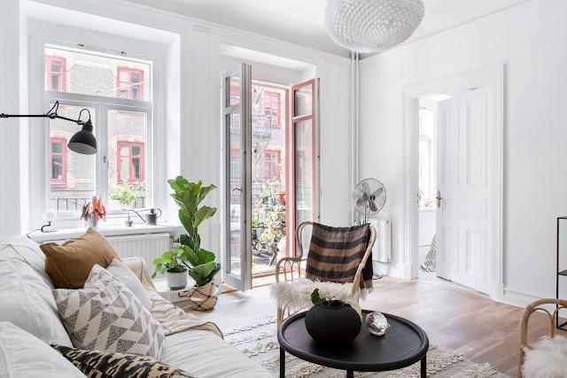 Stil scandinav cu accente de maro deschis în decorul unui apartament de 54 m²