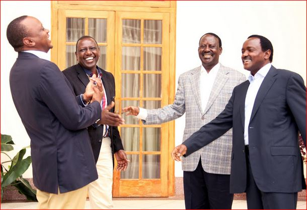 jubilee party leaders uhuru kenyatta and william ruto laughing out loud with the opposition leaders raila odinga and kalonzo musyoka
