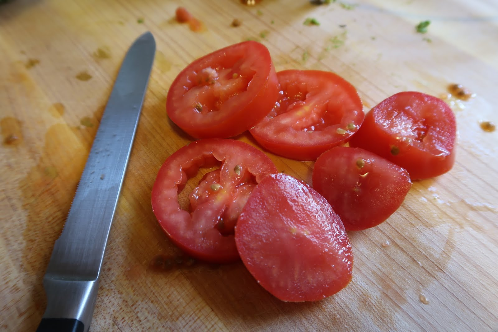 tomatoes knife cutting board guacamole recipe