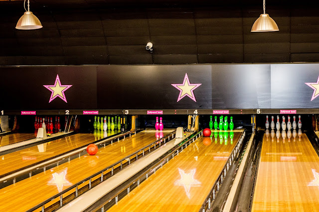 View of the Hollywood Bowl VIP lanes with balls heading towards the pins