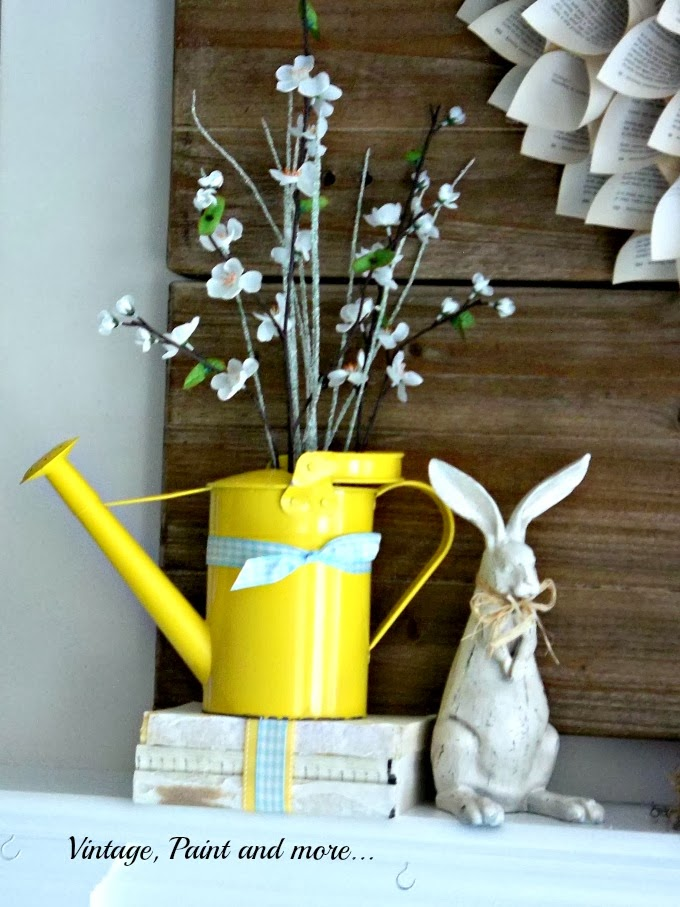 Spring Mantel - vintage rabbit, watering can, altered books, spring flowers