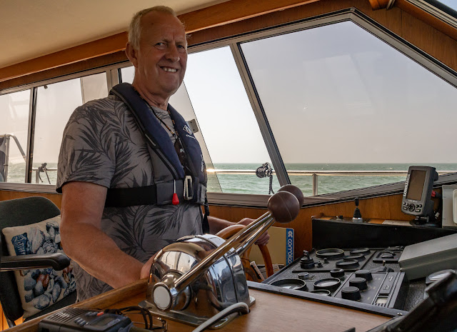 Photo of Phil at Ravensdale's helm during our fishing trip on Saturday