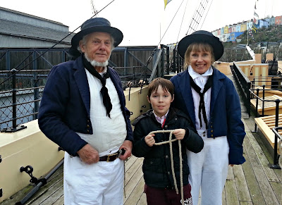 Boy with staff dressed as sailors aboard SS Great Britain