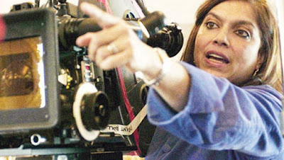 Mira Nair directs an actor in a scene