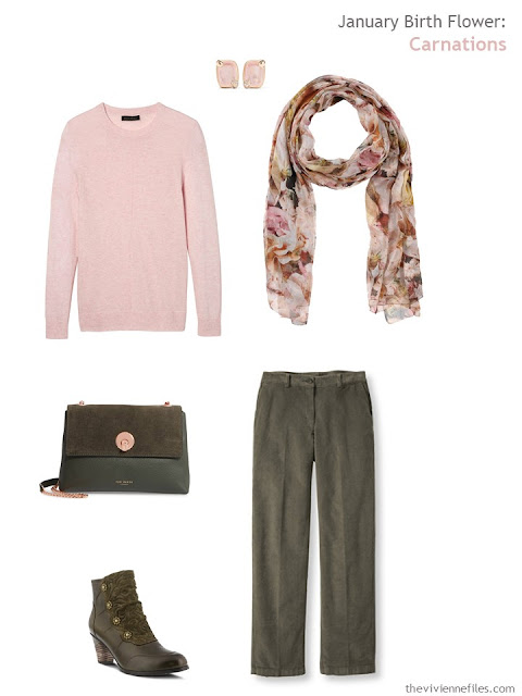 wearing a carnation pink sweater with olive green