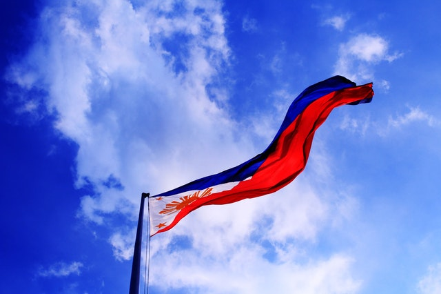 The Philippine flag flying high in a government office