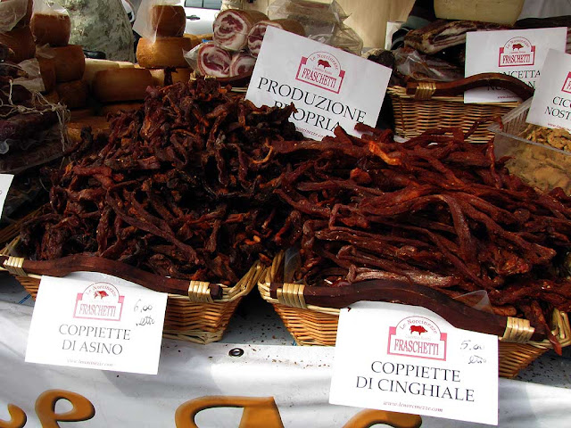 Donkey and wild boar coppiette: strips of meat spiced and dried, food fair, Livorno