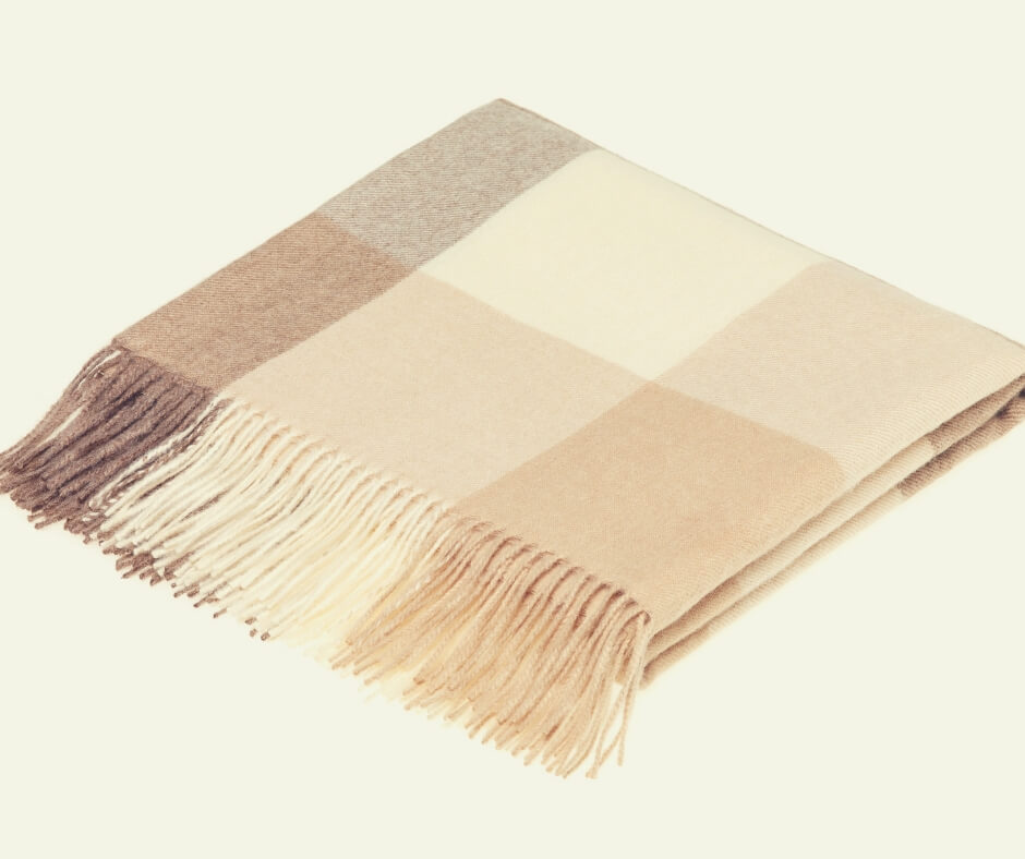 Christmas Gift Ideas For Your Mother In Law | A lovely, natural coloured throw made from alpaca wool, something your mother-in-law will love.