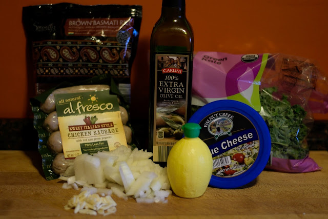 The ingredients needed to make the chicken sausage and kale over rice recipe.