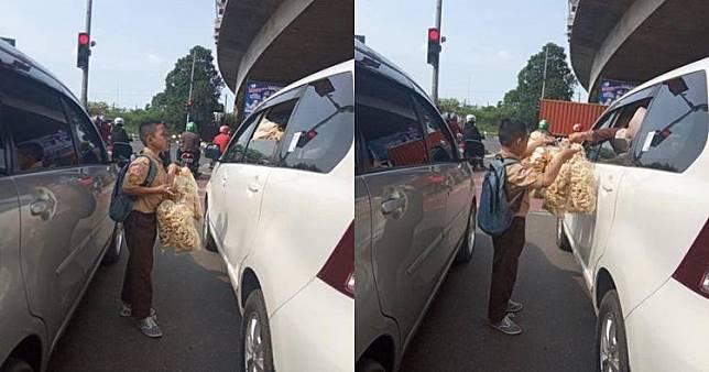 Viral Anak SD Berseragam Berseragam Nyambi Jadi Pedagang Asongan di Perempatan Jalan