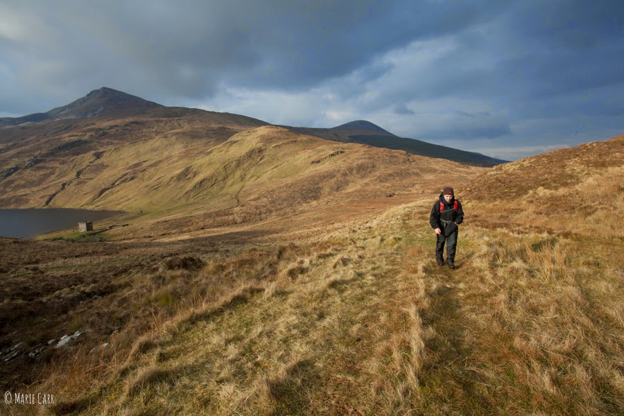 Hillwalker in the hills of Donegal, walking back from Lough Altan