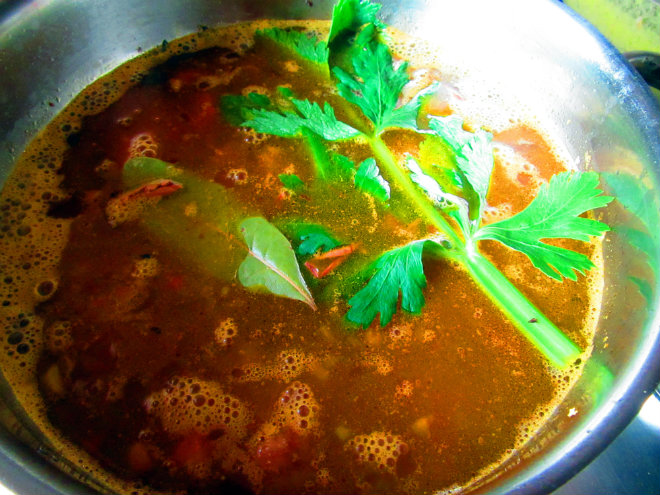 Bean and barley stew by Laka kuharica: add beans, bay and celery leaf, water, and salt.