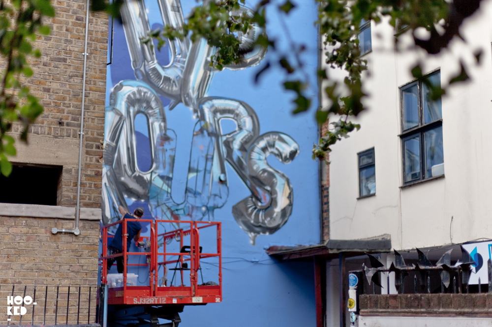 Hyper-realistic 'Up Yours'  helium balloon Mural by London graffiti artist Fanakapan