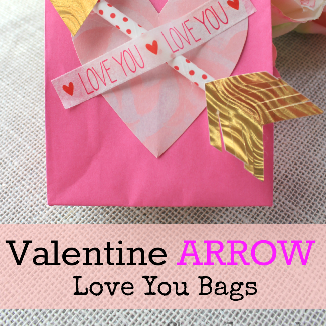 Pink gift bag with a heart and paper arrow