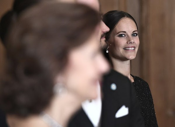 Crown Princess Victoria, Prince Daniel, Prince Carl Philip and Princess Sofia at Sverigemiddag. Princess Victoria wore Ann-Sofie Back dress style dress, gown. Crown Princess Victoria wore Ann-Sofie Back gown, Princess Sofia wore Kay Senchai gown